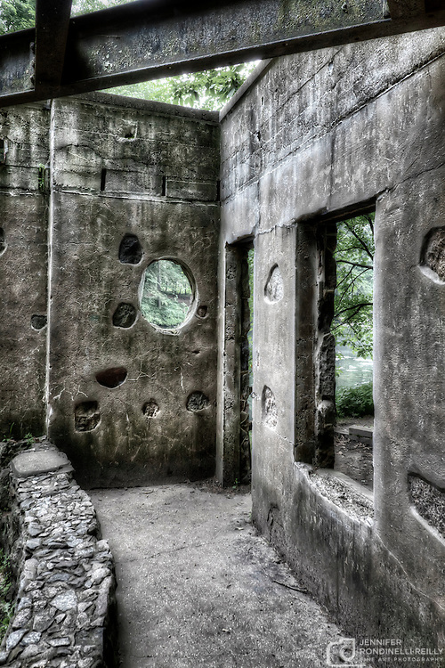 The decaying Paradise Spring House. Paradise Springs is located in Eagle, WI and the flat, aspahlt trail that leads to the abandoned spring house can be found in the southern part of the Kettle Moraine forest.