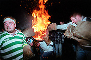 """PASSING THE BARREL"".TAR BARRELS OF OTTERY ST MARY HELD EVERY NOVEMBER THE 5TH..RUPERT RIVETT©2003..07771928201"