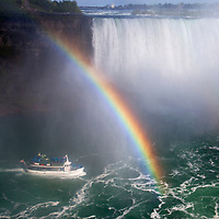 Canada, Ontario, Niagara Falls. Maid of the Mist and rainbow at Niagara Falls.