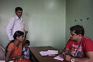 India, Maharashtra. Association Dalit Mahila Vikas Mandal which provides counselling to couples that have disputes. <br /> Swarna gestured to her husband Ashok accusing him of beating her.<br /> Alessio Romenzi