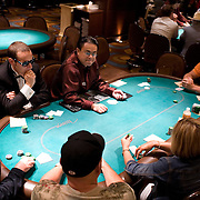 Jonathan Thompson (2nd left) takes part in  the poker tournement at the Mirage poker room, Las Vegas.