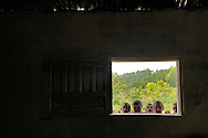 Children peek through a window into a room where an American doctor is visiting to offer assistance to the villagers in Majastre, Honduras.   Honduras is considered the third poorest country in the Western Hemisphere (Haiti, Nicaragua). With over 50% of the population living below the poverty line and 28% unemployed, Hondurans frequently turn to illegal immigration as a solution to their desperate situation. The Department of Homeland Security has noted an 95% increase in illegal immigrants coming from Honduras between 2000 and 2009, the largest increase of any country.
