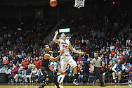 "Mississippi's Marshall Henderson (22) gets an assist off of the backboard vs. Missouri at the C.M. ""Tad"" Smith Coliseum in Oxford, Miss. on Saturday, February 8, 2014. (AP Photo/Oxford Eagle, Bruce Newman)"