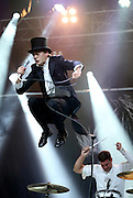 (L-R) Pelle Almqvist and Chris Dangerous of The Hives perform live on the NME Radio 1 Stage during Day One of Reading Festival 2012 at Richfield Avenue on August 24, 2012 in Reading, England.  (Photo by Simone Joyner)