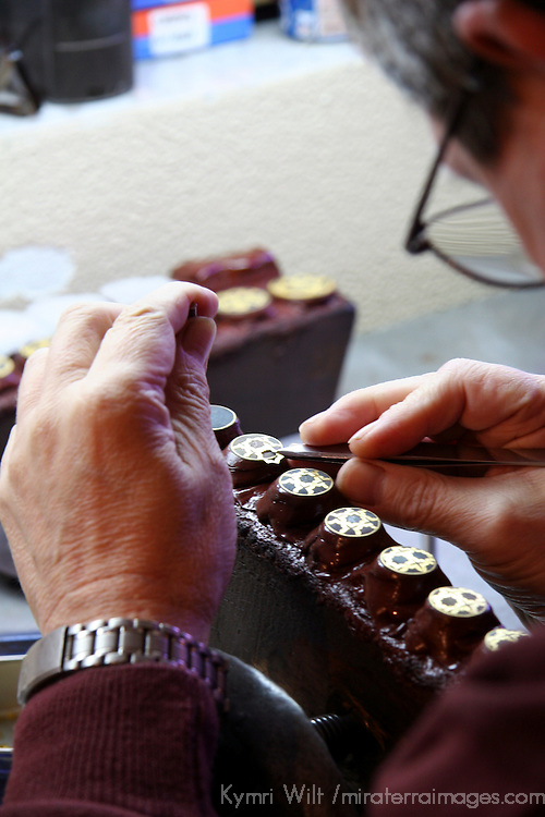 Europe, Spain, Toledo. A swordsmith artisan at work in Toledo, Spain.