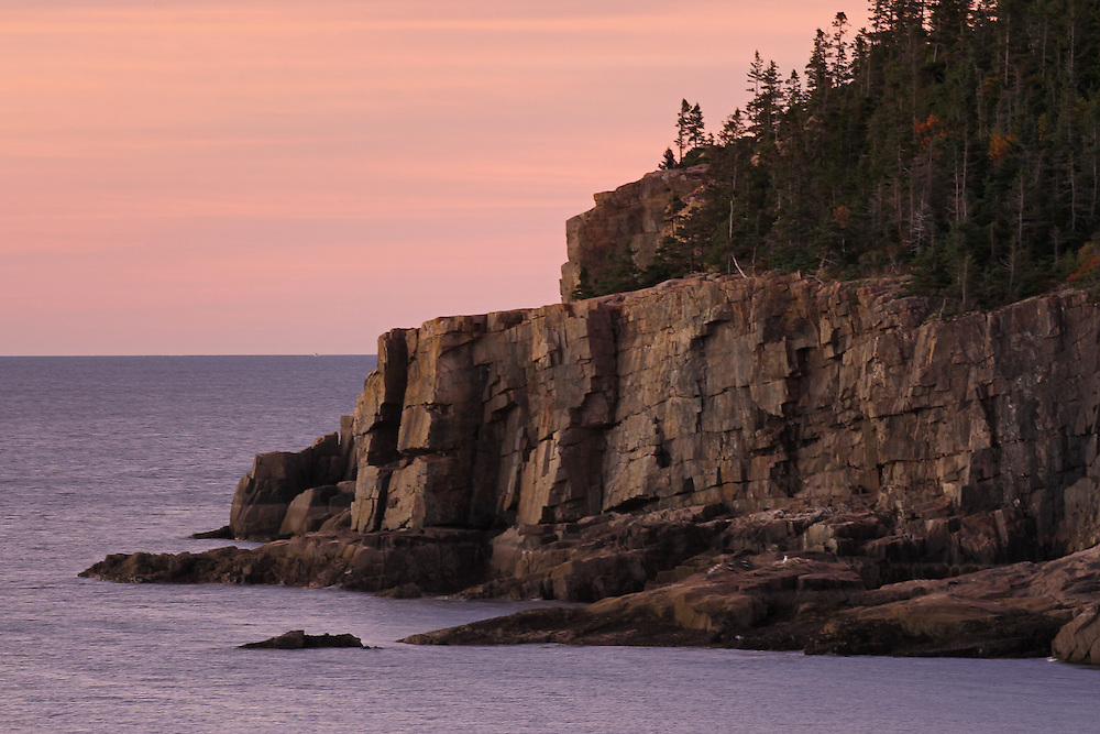 Acadia National Park seascape photography fine art prints are available as museum quality photography prints, canvas prints, acrylic prints or metal prints. Prints may be framed and matted to the individual liking and room decor needs:<br /> <br /> http://juergen-roth.artistwebsites.com/featured/otter-cliff-at-dawn-juergen-roth.html<br /> <br /> Photograph features a classic seacoast photography view of Otter Cliff and the rocky shoreline in Acadia National Park. I was happy to still find fall colors and great light all week long! Acadia National Park is a National Park located in the U.S. state of Maine. It reserves much of Mount Desert Island, and associated smaller islands, off the Atlantic coast. Originally created as Lafayette National Park in 1919, the first National Park East of the Mississippi, it was renamed Acadia in 1929. The park is one of the most visited wildlife areas in the United States and a paradise for every photographer and outdoor enthusiast. The park loop road provides easy access to many of the iconic photography subjects, such as Monument Cove, The Beehive, Sand Beach, Jordan Pond and the Bubbles, Bubble Pond, Otter Cliff to name only a few. The carriage roads and hiking trails provide further access to more remote locations where the park continues to inspire and unfolds its full magic. It is a heaven for macro, seascape, and landscape photography that makes for great wall art decoration. Especially sunrise and the light of the golden hours paint the sky in beautiful blue and orange and brings out the beauty of the pink granite rocks..<br /> Good light and happy photo making!<br /> <br /> My best,<br /> <br /> Juergen<br /> Art Prints: www.RothGalleries.com<br /> Image Licensing: www.ExploringTheLight.com<br /> Photo Blog: http://whereintheworldisjuergen.blogspot.com<br /> @NatureFineArt<br /> https://www.facebook.com/naturefineart