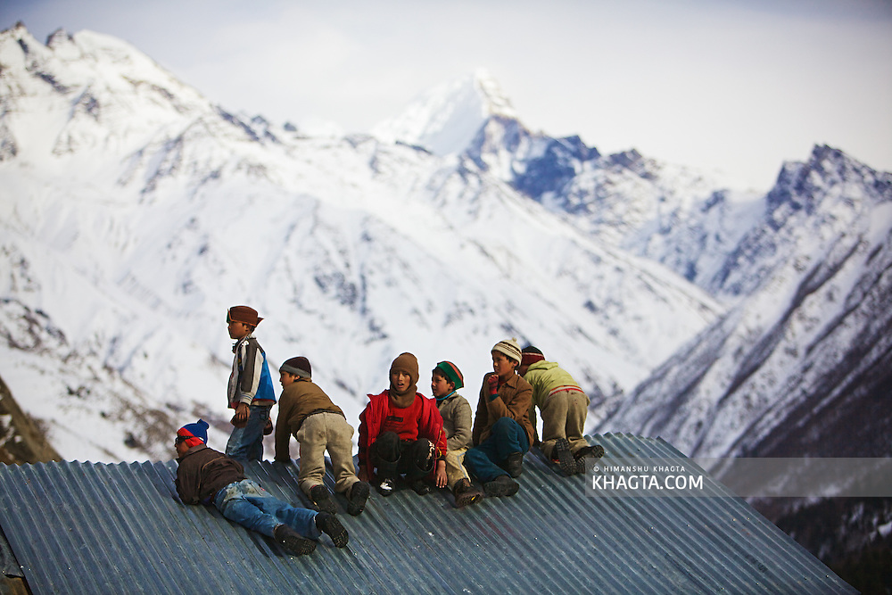 Kids playing on top of a roof at Chitkul, also known as the last village of India. <br /> In winters, this village of Kinnaur, experiences snow of upto 6 ft.