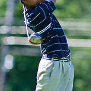 06/30/11 Newark DE: Golfer Nino Rosal (18) hits the ball towards hole 11 during round two of the DSGA and DWGA junior golf championships Thursday, June 30, 2011 at Newark Country Club in Newark Delaware.