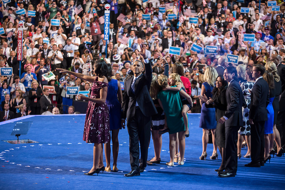President Barack Obama, on stage with his family and that of Vice President Joe Biden, waves after speaking at the Democratic National Convention on Thursday, September 6, 2012 in Charlotte, NC.