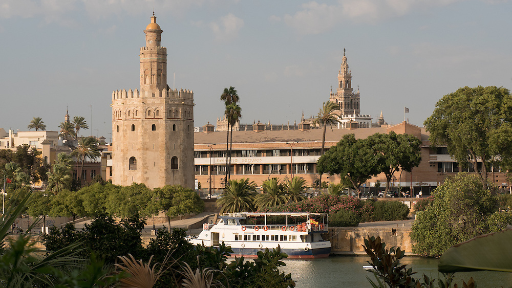 The Torre del Oro is a  military watchtower in Seville, southern Spain. Its name comes from the golden shine it projected on the river, due to its building materials (a mixture of mortar, lime and pressed hay).