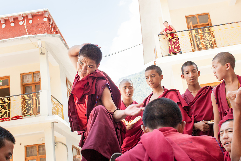 The young Buddhist monks of the Dhakpo <br /> Shedrup Ling monastery at Kais, H.P. India <br /> practice twice every day in a special <br /> form of debating.<br /> <br /> The purpose of these playful discussions is to train the mind in logical thinking and reasoning and prepare for the more complex Bhuddist philosophies that will be a great part of the monk&rsquo;s life in the years to come.