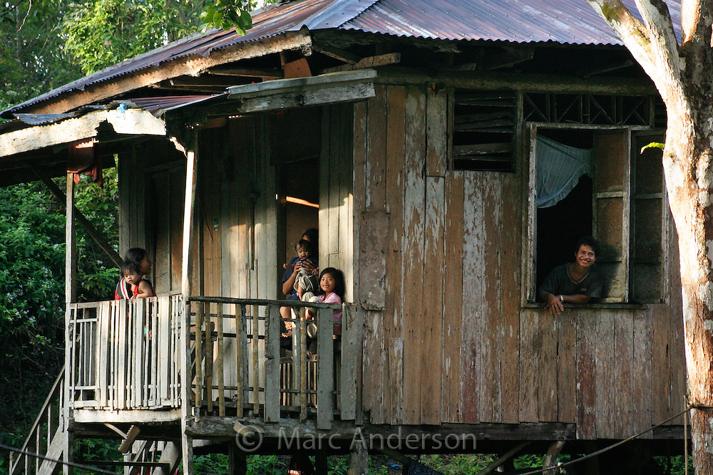 Family in a traditional wooden house, Philippines