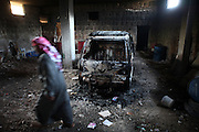 A burnt pick-up truck in a grime coated garage. Deir Sunbul (contested Jabal Al-Zawiha area) was beeing attacked by syrian army in April, leaving several people dead. Many houses were set on fire by Assad loyalists and inhabitants fled the region fearing new attacks.