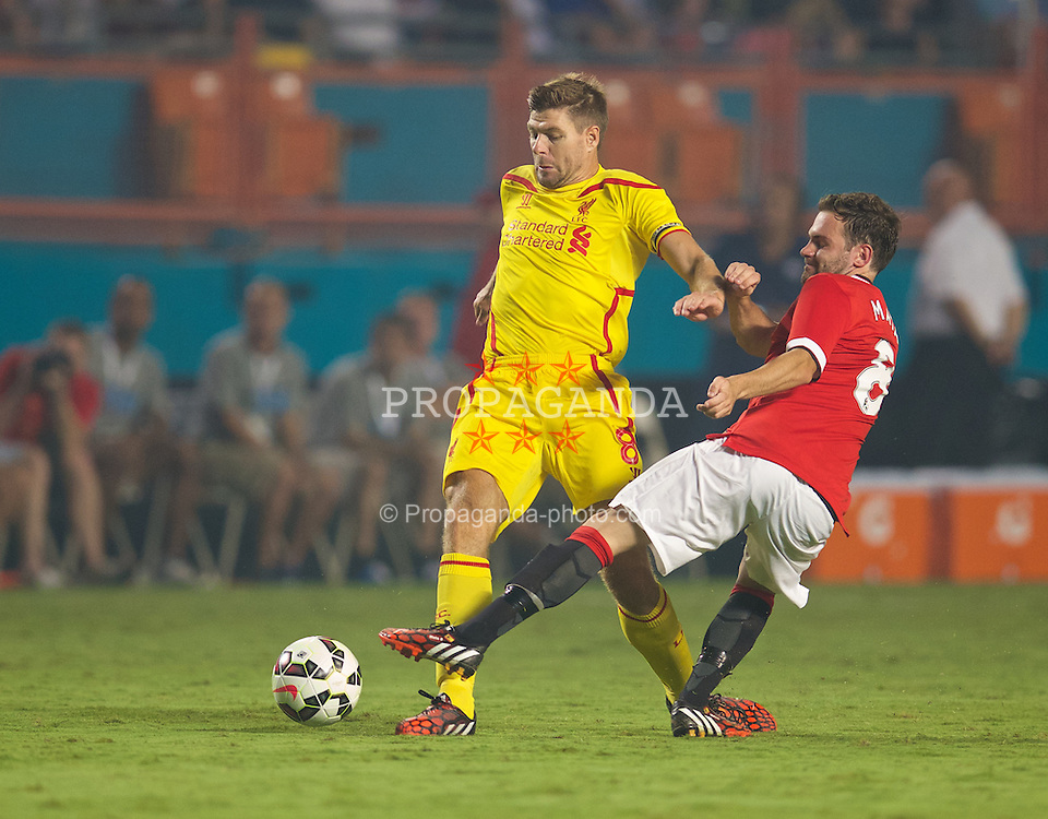 MIAMI, USA - Monday, August 4, 2014: Liverpool's captain Steven Gerrard in action against Manchester United's Juan Mata during the International Champions Cup Final match at the SunLife Stadium on day fifteen of the club's USA Tour. (Pic by David Rawcliffe/Propaganda)
