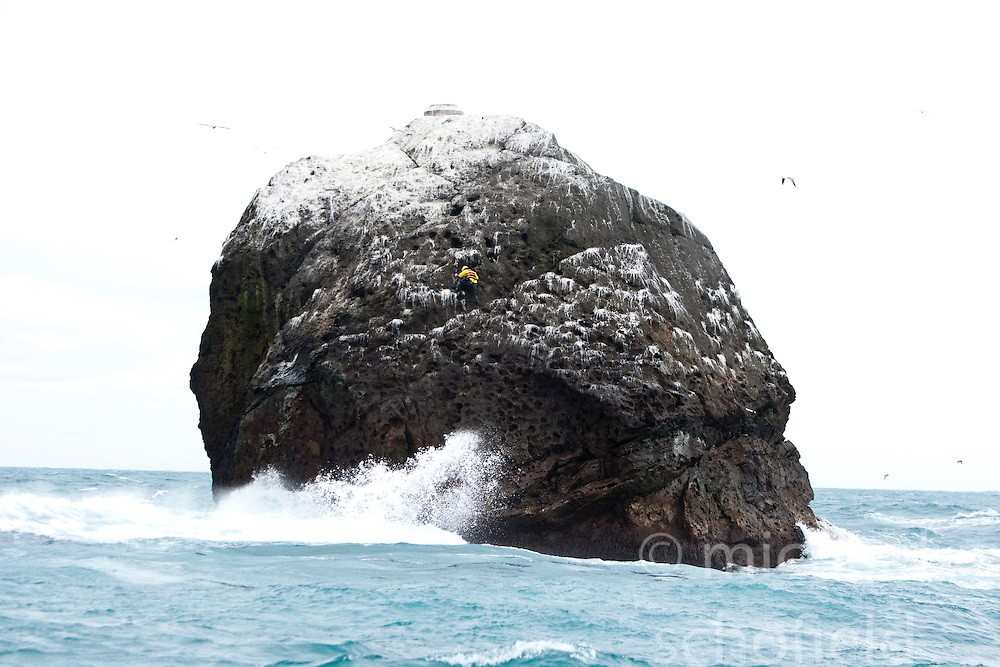 Nick Hancock heads down from the top of Rockall, after his reconnaissance mission for a future 60 day occupation of Rockall. The Rockall Jubilee Expedition, a unique endurance expedition to be undertaken by Nick, in order to raise funds for Help for Heroes .©Michael Schofield..