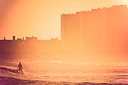 A surfer's silhouette during a sunset session at Rockaway Beach, Quees, NY.