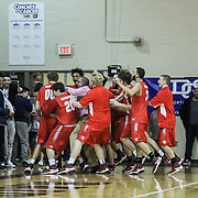 Hazleton Forward Josh Samec (00) and his teammates celebrates the game winning shot to defeat Mount Pleasant 44-43 during the Concord Classic basketball game between Mount Pleasant and the Hazleton Cougars Mon. Jan. 16, 2017 at Concord High School in Wilmington.