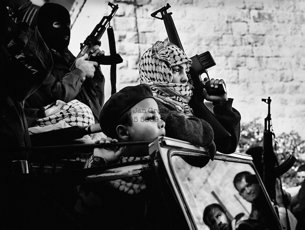 Young Fatah members at the funeral of a martyr from the City Inn front. The children learn the political views of the adults from an early age. <br /> Sep./Nov. 2002.