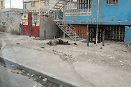 A cadavre lies in the streets of Cité Soleil. Residents claimed UN forces would not allow them to retrieve the body, letting it rot in the streets. Port-au-Prince, Haiti, January 8, 2006.