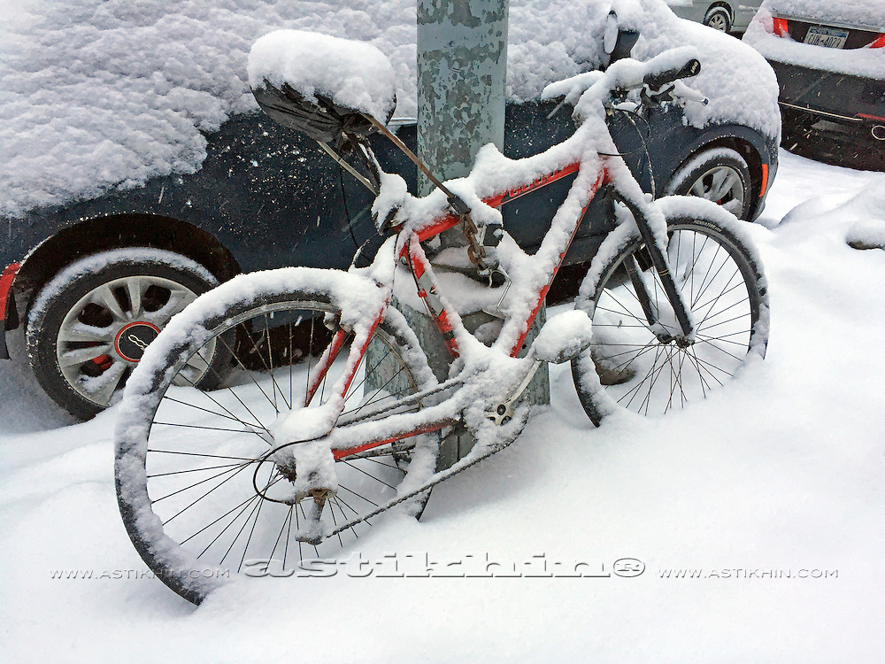 A bike covered under a snow.