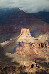 A rainbow forms in front of Isis Temple in Grand Canyon National Park.