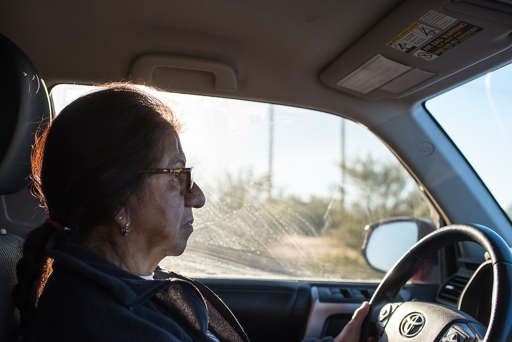 Maria Ochoa, with the humanitarian aid organization Tucson Samaritans, drives into the desert to search for signs of recent migrant trails. The Samaritans make runs several times a week near the U.S.-Mexico border placing water, blankets, and other essential items that people migrating through Mexico may need to survive.