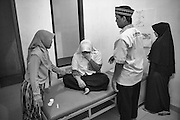 A distressed patient returns for further treatment at the Abu Albani Centre (for mental health) in Bekasi, Jakarta, Indonesia, 2016 - Photograph by David Dare Parker
