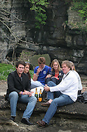 Tim Blackman ( father of murdered UK national Lucy), with daughter Sophie (in sunglasses), partner Jo Burr, and Jo Burr's children Ryan (in black), Luke (in blue) and Alicia (dark haired), as they pay their respects to Lucy by visiting the cave and drinking champagne in her memory on the beach where her dismembered body was found, Aburatsubo beach, near Tokyo, Japan on Monday, April 23rd 2007.  The verdict will be announced in the trial of Joji Obara for Lucy Blackman's murder (and rapes of other women) on Tuesday April 24th 2007,