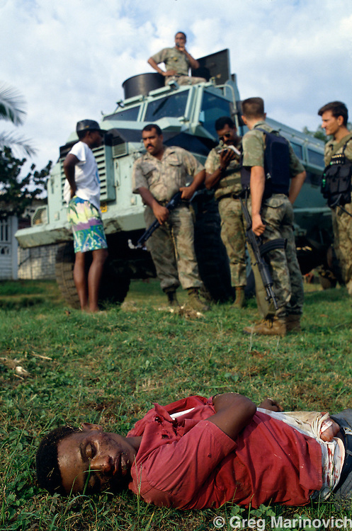 KwaMashu township, KwaZulu Natal, South Africa 1994. Police stand near a dead body of a man shot from a car in KwaMashu township.