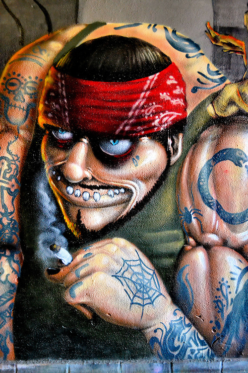 Pirate face red bandana tattoos covering steroid arms for Back mural tattoos