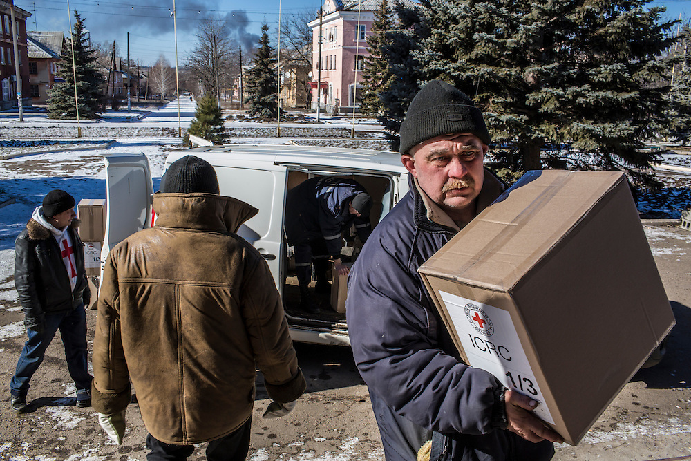 MYRONIVSKYI, UKRAINE - FEBRUARY 17: Humanitarian aid is brought to the local House of Culture for distribution to local residents on February 17, 2015 in Myronivskyi, Ukraine. A ceasefire agreed to by Ukraine and pro-Russian rebel forces has failed to prevent fighting in the nearby town of Debaltseve, where thousands of Ukrainian troops remain and whom rebels claim to have surrounded. (Photo by Brendan Hoffman/Getty Images) *** Local Caption ***