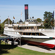 The Ticonderoga (built in 1906, 220 feet long) is America's last remaining side paddlewheel passenger steamer with a vertical beam engine, and is a National Historic Landmark. The steamship Ticonderoga transported passengers and goods up and down Lake Champlain for many years, then in 1955 was moved two miles overland on special tracks to the Shelburne Museum. The Shelburne Museum is one of the finest, most diverse, unconventional museums of American folk art. Visit this extensive museum in the town of Shelburne, near Lake Champlain, in Vermont, USA. Electra Havemeyer Webb, an avid collector of American folk art, founded the Museum in 1947.