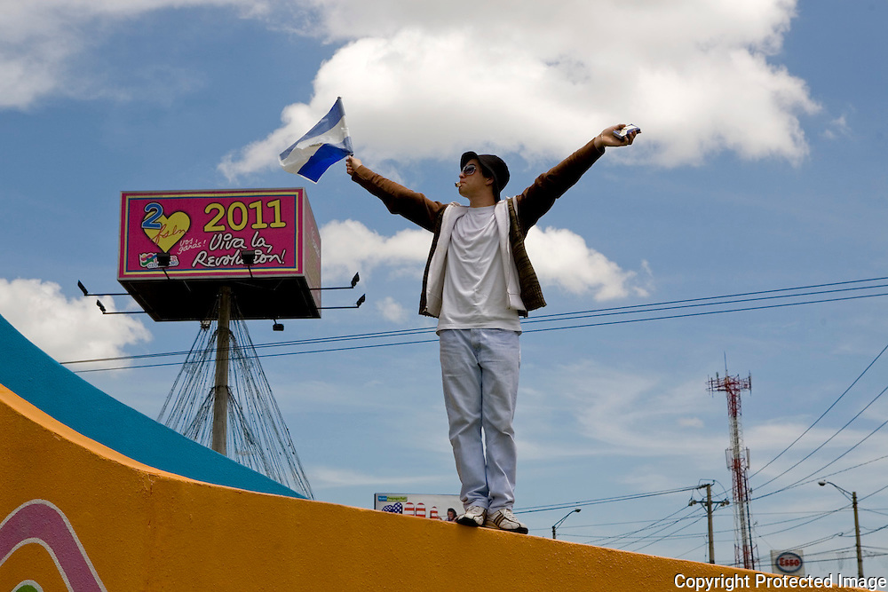 A protester stands alone in front of an Ortega Sign at the Contra Ortega Protest, Nicaragua