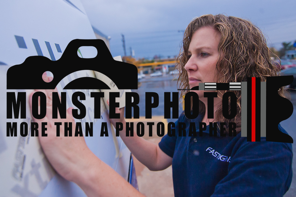 10/27/10 Wilmington DE: FastSigns Assistant Production Manger Nadine Trotter as she finishing touches on a logo sign applied to the sides of the vans of owned by EBC Carpet Services Corp. it took one & half days to wrap vehicle..Special to The News Journal/SAQUAN STIMPSON