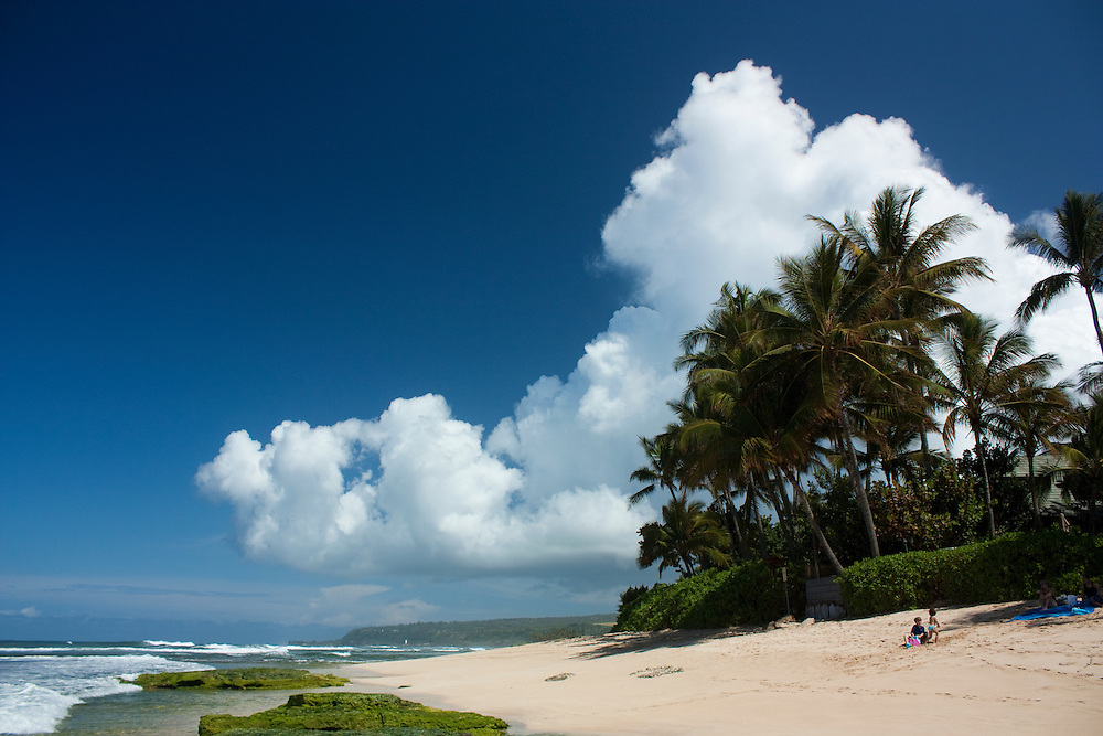 North shore beach, cloud formations and blue sky, Oahu, Hawaii