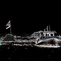 Fishing boat returning at dawn to Jaffa Port