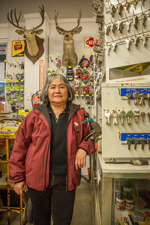 """""""I've worked here for 17 years.  I live in Windsor...and could work closer to home...but I continue to work here...I will probably retire here.""""  -Hardware sales associate Maria Rivera prepares to copy a key at the ACE Hardware store in downtown Calistoga."""