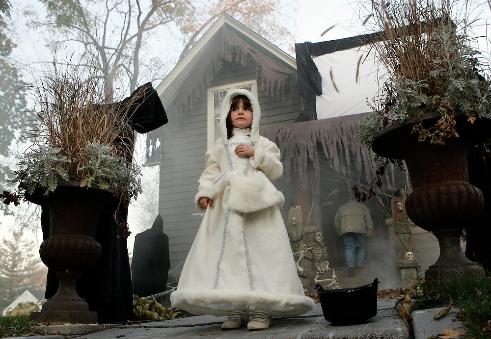 Ahna Doherty, 5, stands in front of her home while waiting for trick-or-treaters on Halloween Friday, Oct. 31, 2008, on N. Prospect Street in Rockford.<br /> SCOTT MORGAN | ROCKFORD REGISTER STAR