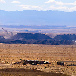 An abandoned home sits near the Navajo Mine of Fruitland, N.M. Draglines operate at the mine 24-hours a day.