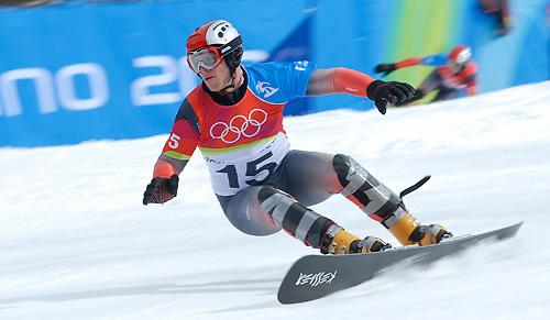 Gold medal winner of the Mens Parallel Slalom snowboarding, Philipp Schoch from Switzerland...Photo/Matt Crossman.