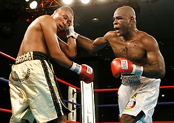 January 5, 2008; Newark, NJ, USA;  Former light heavyweight champion Glen Johnson (white trunks) and Hugo Pineda (gold trunks) trade punches during their 10 round light heavyweight bout at Bally's Ballroom in Atlantic City, NJ.  Johnson won via 8th round TKO.