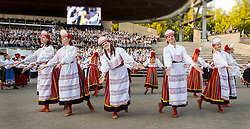 Song Festival 2014 in Tartu, Estonia. Folk dancers in national dress.