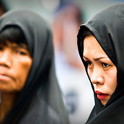 MANILA (Philippines). 2009. Women in a Holy Week procession near Quiapo church.