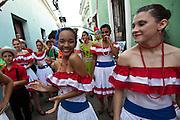 Dancers parade through the streets of Old San Juan during the Festival of San Sebastian in San Juan, Puerto Rico.