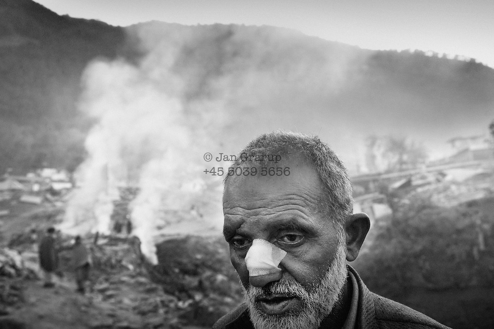 Hadyatullah in front of his tent on the outskirts of Balakot. He and his wife lost two sons and two daughters when the earthquake crushed the children's school.  Nov. 2005