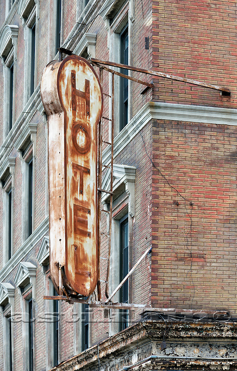 Rust stained metal Hotel sign.