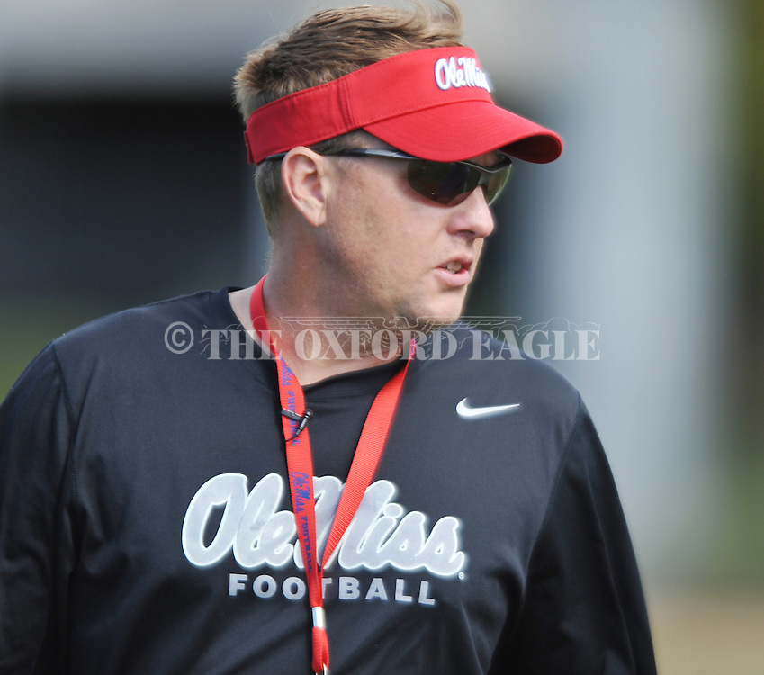Head coach Hugh Freeze, in his first year as head coach, watches as Mississippi began spring practice in Oxford, Miss. on Friday, March 23, 2012. (AP Photo/Oxford Eagle, Bruce Newman)