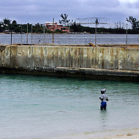 Swimming at the British Colonial Beach in downtown Nassau in The Bahamas.