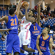 Delaware 87ers Forward Malcolm Lee (14) attempts to pass the ball as Westchester Knicks Forward Orlando Sanchez (21) and Westchester Knicks Guard Langston Galloway (11) defends in the first half of a NBA D-league regular season basketball game between the Delaware 87ers and the Westchester Knicks (New York Knicks) Sunday, Dec. 28, 2014 at The Bob Carpenter Sports Convocation Center in Newark, DEL
