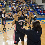 Northeastern forward Jewel Tunstull (42) (Middle) high fives her teammate during player introductions prior the start of a Colonial Athletic Association conference Basketball Game against Delaware Sunday, Feb. 26, 2012, at the Bob Carpenter Center in Newark, Del.